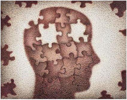 Cabeza formada por puzzle que le faltan dos piezas
